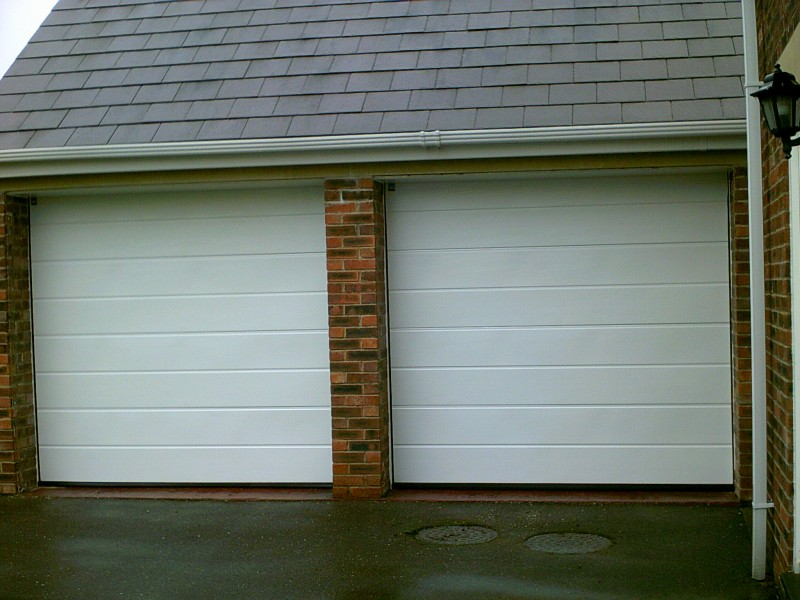 White Sectional Smooth Finish Garage Door (After)