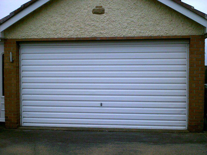 white rib Style Sectional Garage Door (Before)