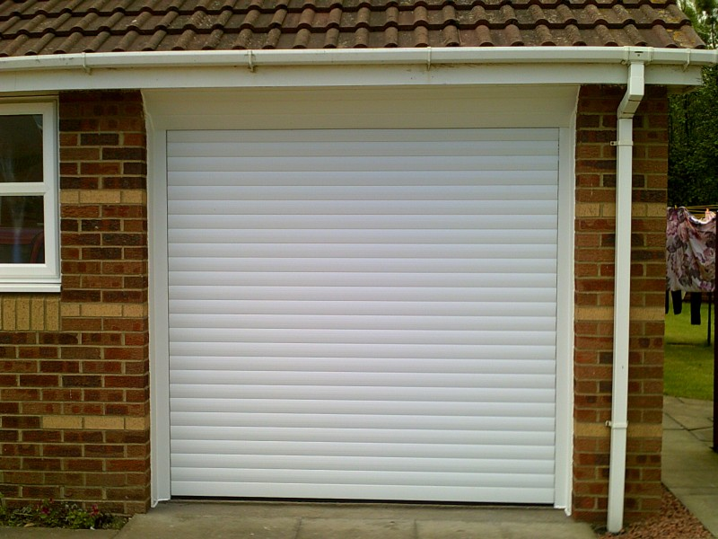 White Seceuroglide Remote Control Insulated Roller door (After)