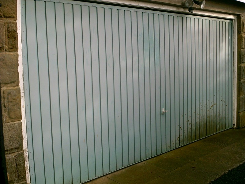 Blue Seceuroglide Remote Control Insulated Roller Garage Door (Before)