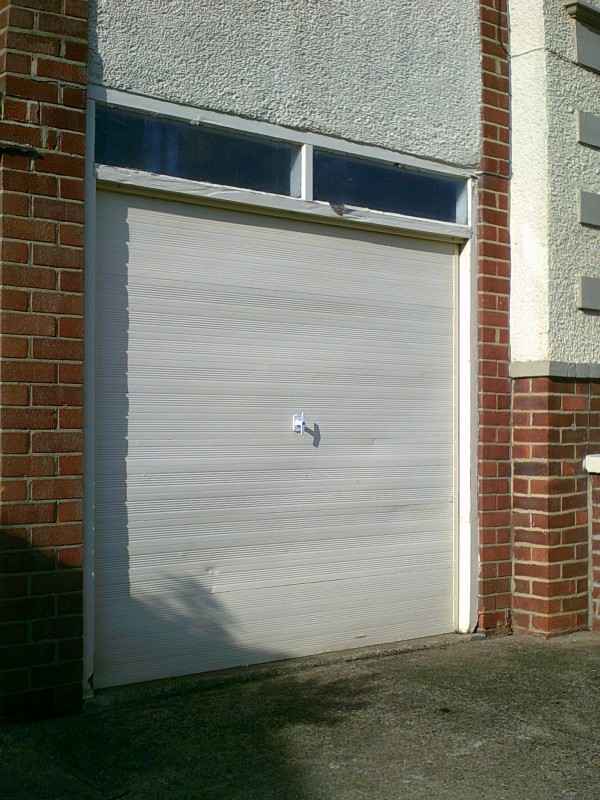 White Vertical Rib Style Garage Door (Before)