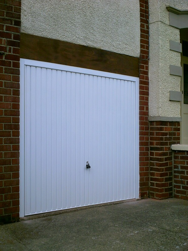 White Vertical Rib Style Garage Door (After)