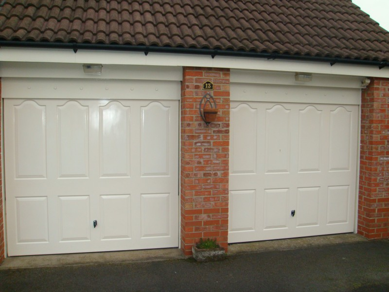 Cream Insulated Sectional Garage Doors (Before)