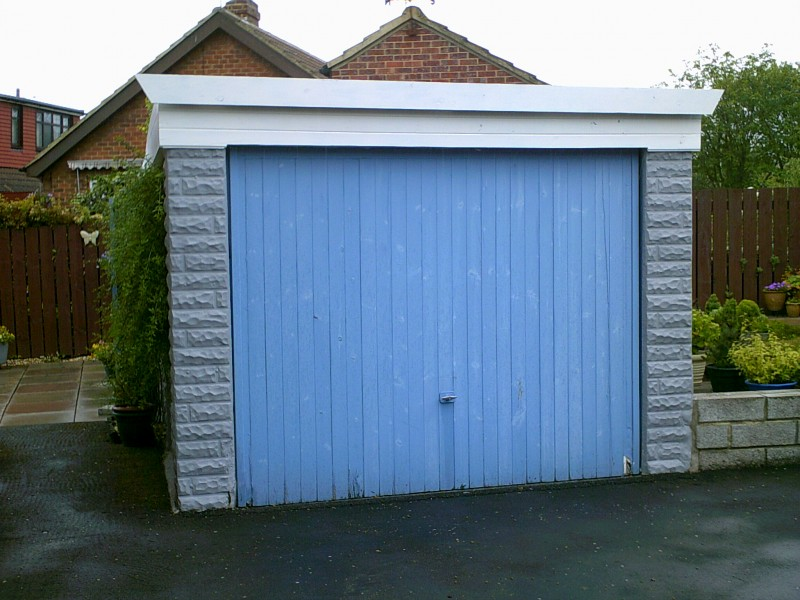 White Rib Style Up and Over Garage Door (Before)
