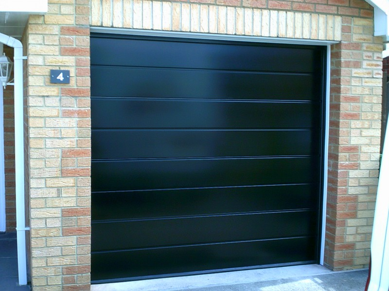 Black Insulated Rib Sectional Garage Door (After)