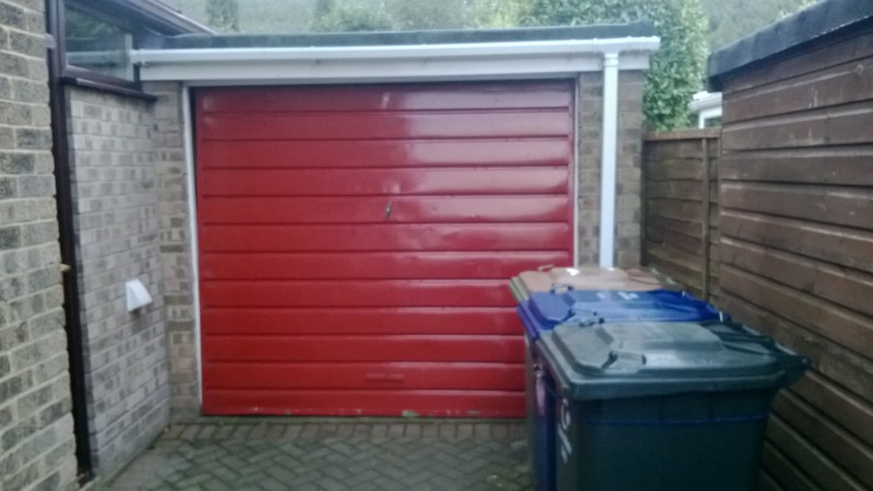 Rosewood Sectional Garage Door (Before)