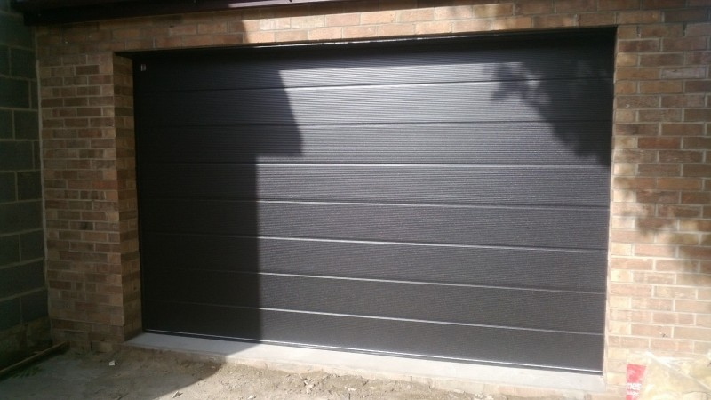 Black Micro Rib Style Sectional Garage Door (After)