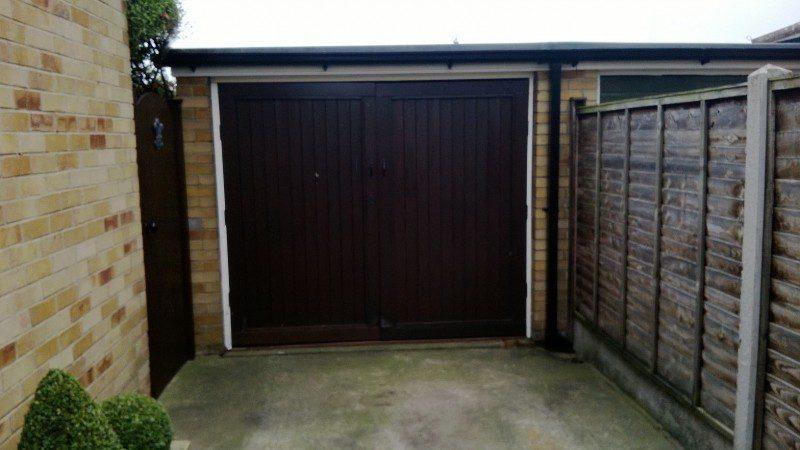 Golden Oak Laminated Insulated Roller Door (Before)