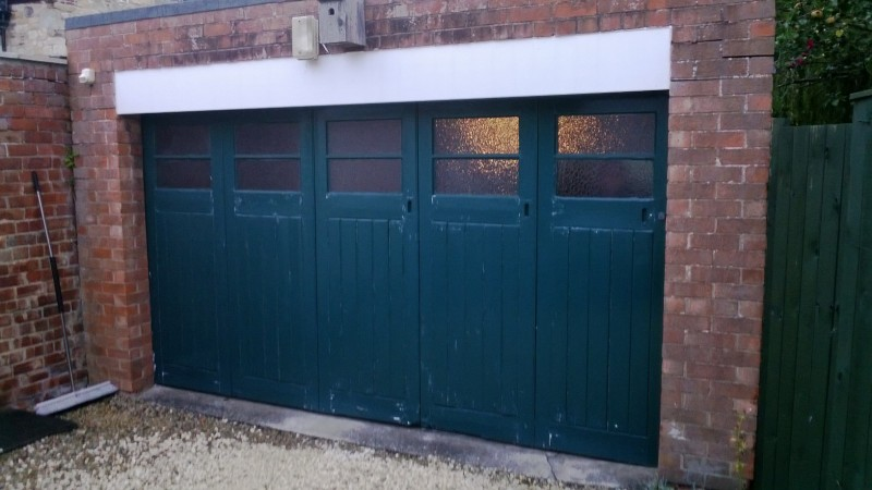 Black Sectional Garage door (Before)