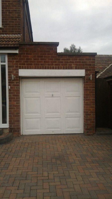 Golden Oak Laminated up and over garage door (Before)