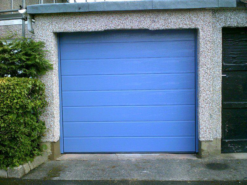 Blue Sectional Garage Door (After)