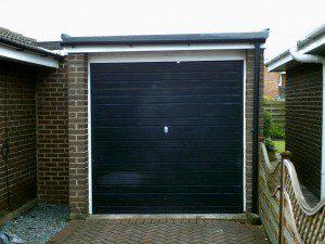 Green Carlton Garage Door (Before)