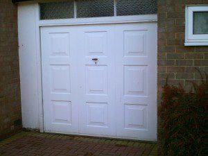 Blue Insulated Roller Garage Door  (Before)