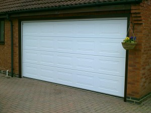 White Sectional Garage Doors (After)