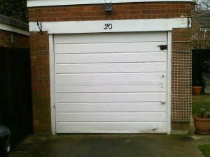 White Horizon Up and Over Garage Door (Before)