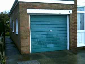 Green Up and Over Garage Door (Before)