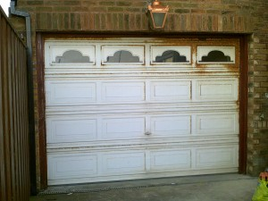 White Georgian Sectional Garage Door (Before)