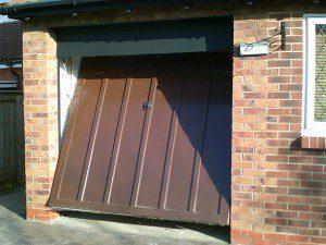 Red Insulated Roller Garage Door (Before)
