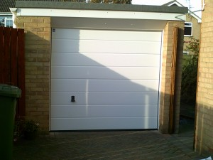 White Sectional Garage Door (After)