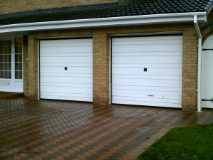 White Manual Insulated Roller Garage Doors (Before)
