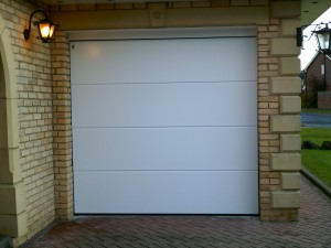 White Linear Sectional Garage Door (After)
