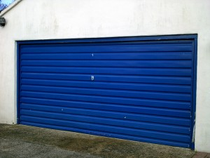 Linear Style Blue Sectional Garage Door (Before)