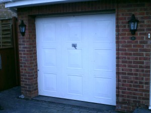 White Insulated Roller Door with Vision Lathes (Before)