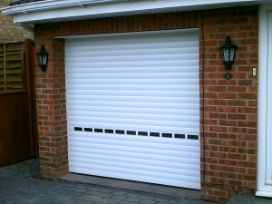 White Insulated Roller Door with Vision Lathes (After)