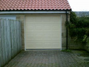 Ivory Sectional Garage Door (After)