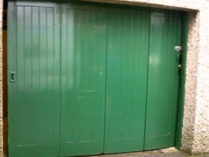 Moss Green Georgian Sectional Garage Door (Before)