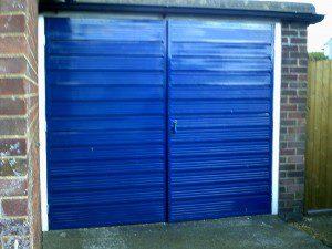 Golden Oak Sectional Garage Door  (Before)