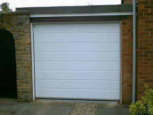 White Woodgrain Sectional Garage Door  (After)