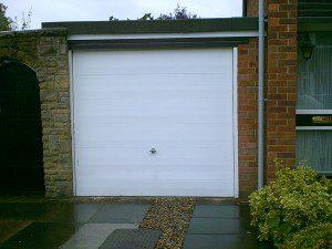 White Woodgrain Sectional Garage Door  (Before)