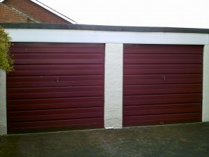 Red Woodgrain Sectional Garage Door (Before)
