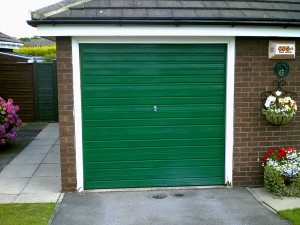 Moss Green Sectional Garage Door (Before)