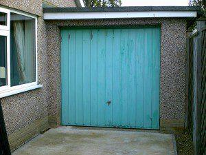 White Garador Sectional Garage Door (Before)