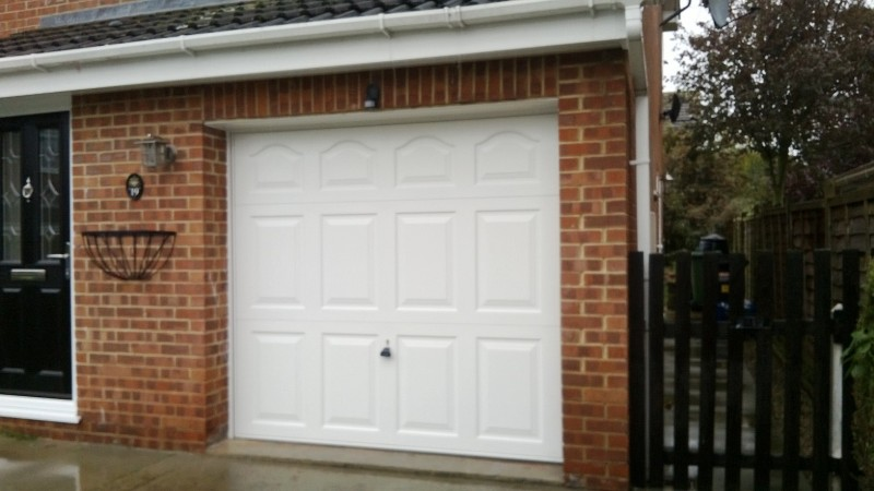 White Cathedral Style Up and Over Garage Door (After)