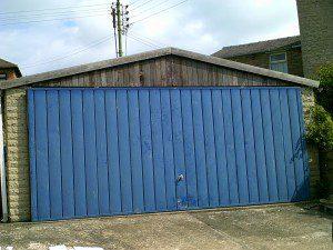 White Insulated Roller Garage Door (Before)