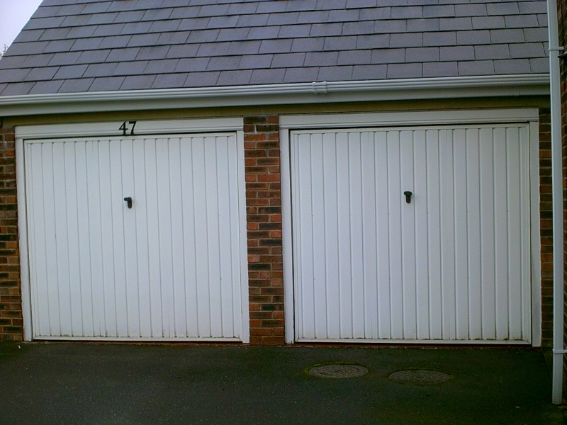 White Sectional Smooth Finish Garage Door (Before)
