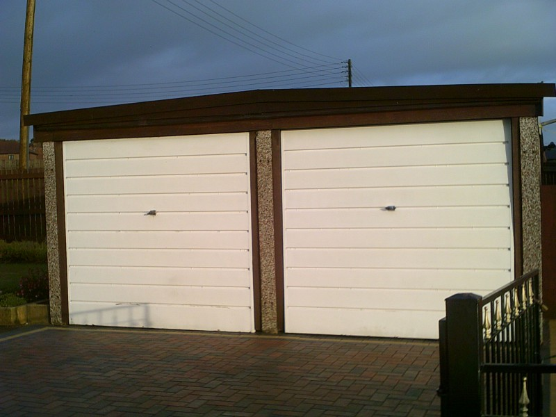 White Linear Sectional Garage Doors (Before)