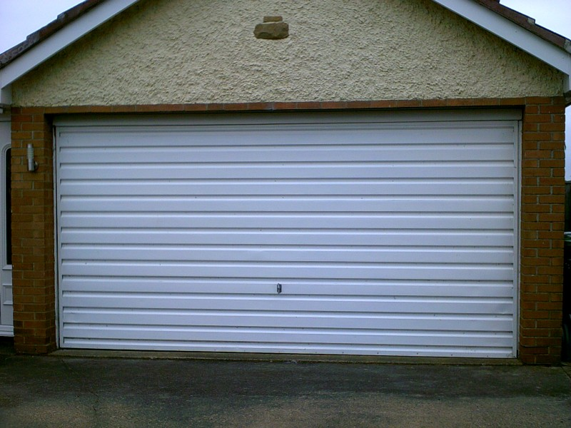 white rib Style Sectional Garage Door (Before)