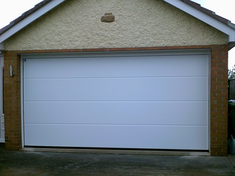 white rib Style Sectional Garage Door (After)