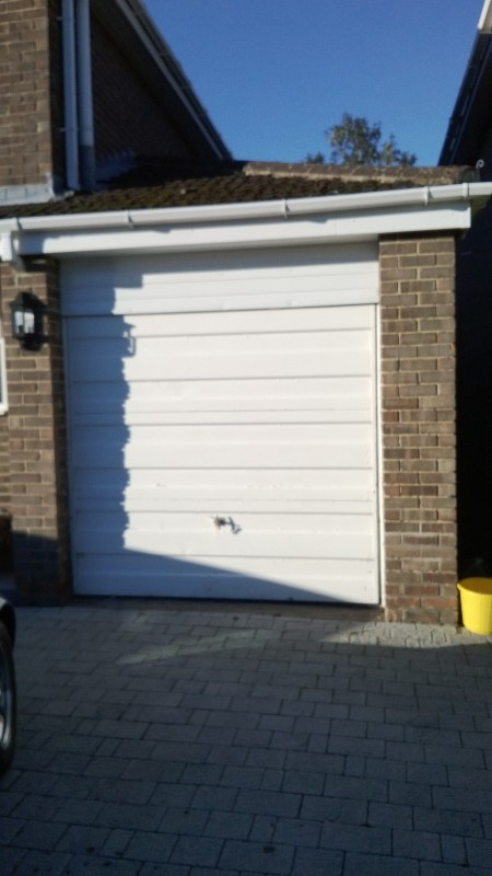 Blue Sectional Garage Door (Before)