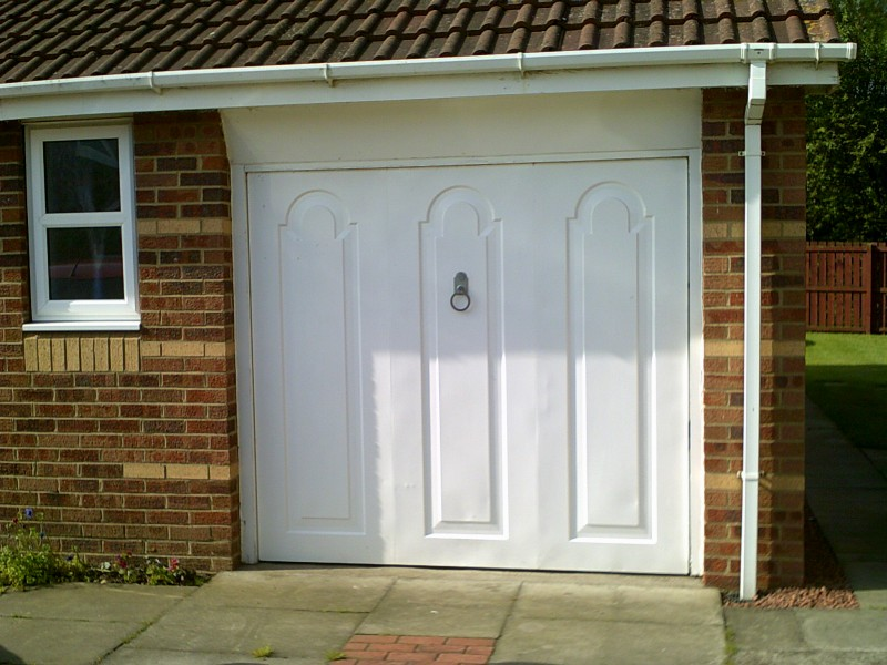White Seceuroglide Remote Control Insulated Roller door (Before)