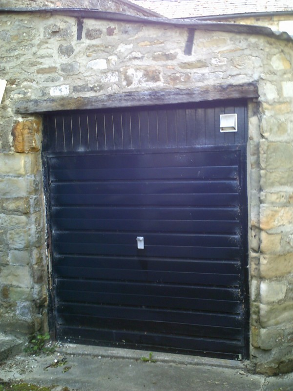 Seceuroglide Remote Control Insulated Rosewood Roller Style Garage Door  (Before)