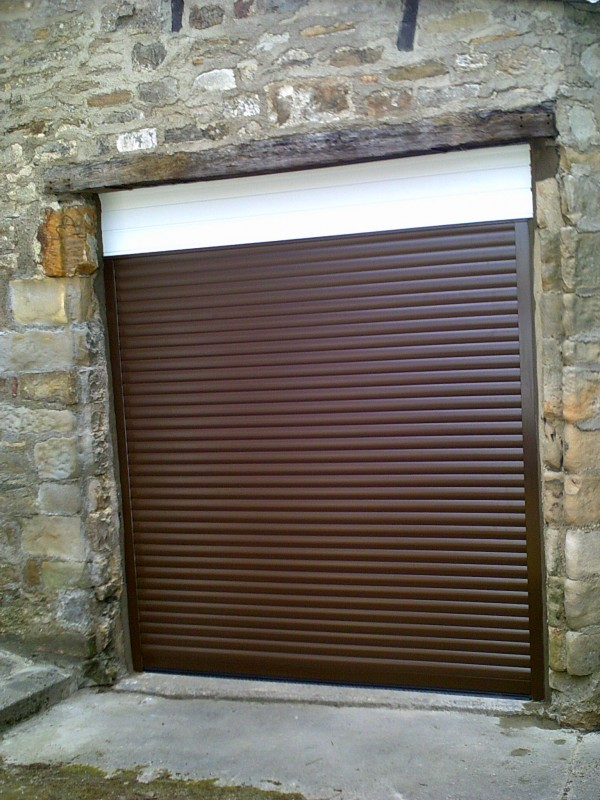 Seceuroglide Remote Control Insulated Rosewood Roller Style Garage Door  (After)