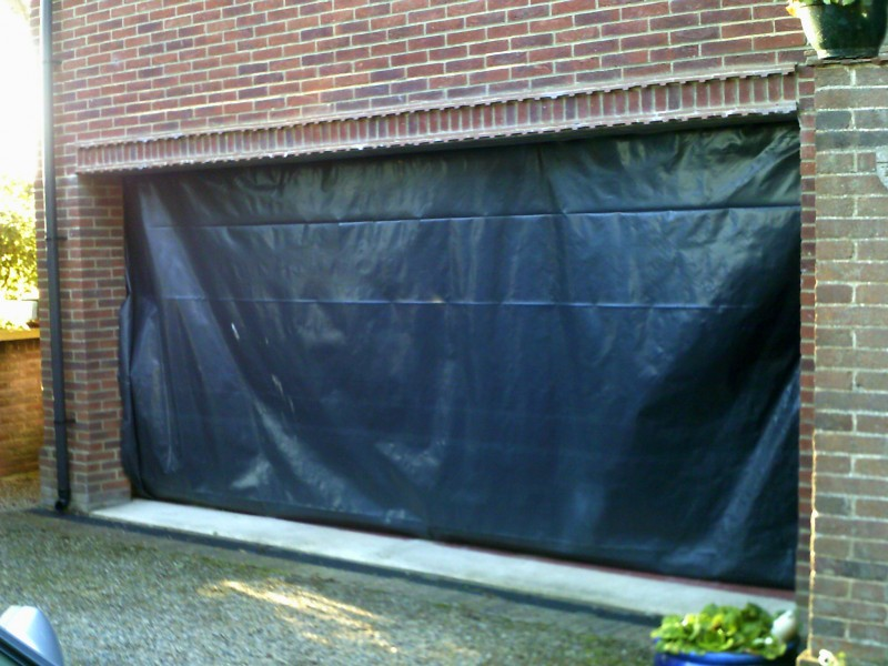 White Insulated Double Size Sectional Garage Door (Before)