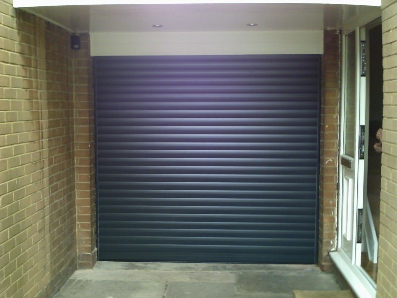 Seceuroglide Grey Remote Control Insulated Roller Garage Door (After)