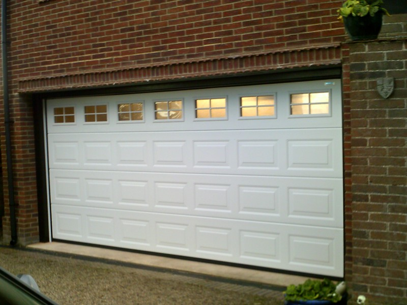 White Insulated Double Size Sectional Garage Door (After)