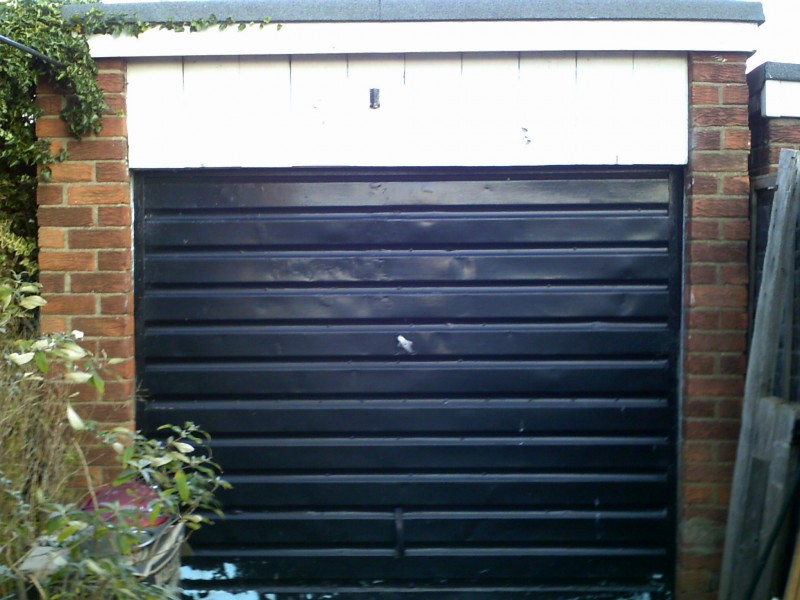White Horizontal Rib Style Up and Over Garage Door (Before)